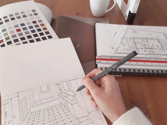 photo d'architecte d'intérieur en train de dessiner
